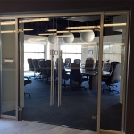 Glass conference room with frameless glass doors