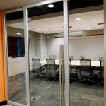 glass door with locking door pull meeting room