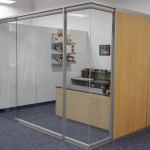 View series glass office front with Flex series solid sidewall
