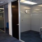 View series glass walls with dark veneer doors