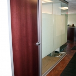 Wood veneer swing door on View series glass office