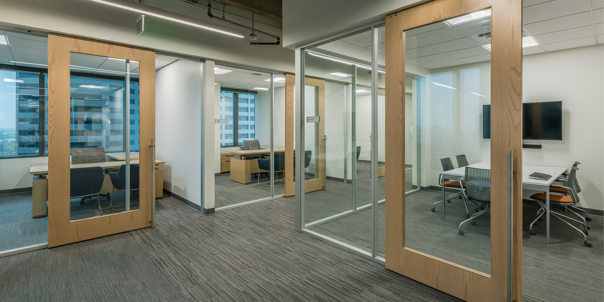 Flex Series glass offices with wood frame sliding doors